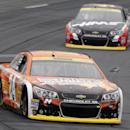 Jeff Gordon keeps a lead over Kurt Busch during practice for Sunday's NASCAR Sprint Cup Series auto race at New Hampshire Motor Speedway, Saturday Sept. 20, 2014, in Loudon, N.H. (AP Photo/Jim Cole)
