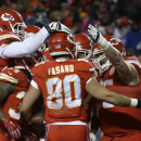 Kansas City Chiefs players celebrate with Kansas City Chiefs tight end Anthony Fasano (80) after he scored a touchdown against the Denver Broncos in the first half of an NFL football game in Kansas City, Mo., Sunday, Nov. 30, 2014 The Associated Press