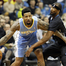 Denver Nuggets's Wilson Chandler, left, keeps the ball away from Minnesota Timberwolves' Corey Brewer in the first quarter of an NBA basketball game on Wednesday, Nov. 27, 2013, in Minneapolis The Associated Press