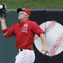 Los Angeles Angels' J.B. Shuck catches a long fly ball hit by Los Angeles Dodgers' Mike Baxter during an exhibition spring training baseball game Thursday, March 6, 2014, in Tempe, Ariz The Associated Press
