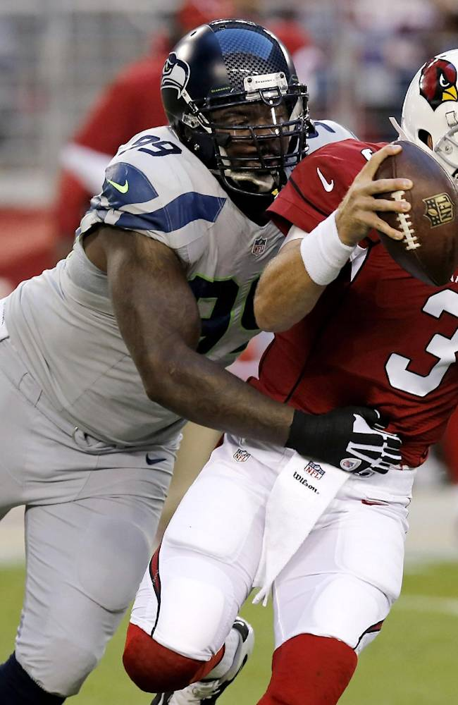 Arizona Cardinals quarterback Carson Palmer (3) is sacked by Seattle Seahawks defensive tackle Tony McDaniel (99) during the first half of an NFL football game, Thursday, Oct. 17, 2013, in Glendale, Ariz
