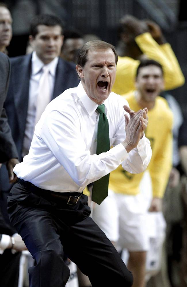 Oregon coach Dana Altman reacts from the bench during the first half of an NCAA college basketball game against Arizona State in Eugene, Ore., Tuesday, March 4, 2014