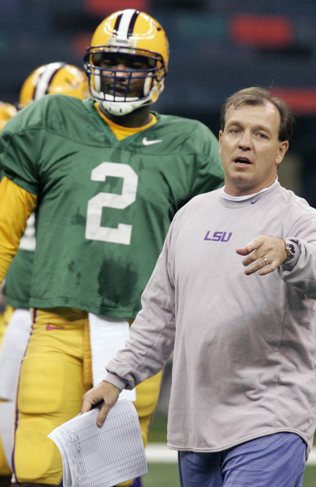 In this Dec. 30, 2007, file photo, then-LSU offensive coordinator Jimbo Fisher and starting quarterback JaMarcus Russell (2) talk at practice in New Orleans. Florida State's Jimbo Fisher may be the pre-eminent quarterback coach in college football. Fisher helped turn JRussell into the first overall pick in the 2007 NFL draft when he was at LSU