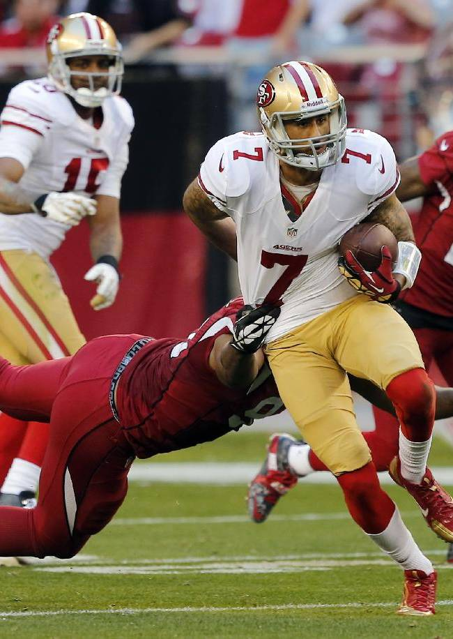 San Francisco 49ers quarterback Colin Kaepernick (7) breaks free of the tackle by Arizona Cardinals defensive end Calais Campbell during the second half of an NFL football game, Sunday, Dec. 29, 2013, in Glendale, Ariz. The 49ers won 23-20