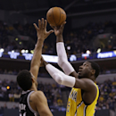Indiana Pacers center Roy Hibbert, right, shoots over San Antonio Spurs forward Tim Duncan in the first half of an NBA basketball game in Indianapolis, Monday, March 31, 2014 The Associated Press