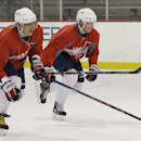 Washington Capitals captain Alex Ovechkin, left, and center Nicklas Backstrom do sprints during a Capitals hockey practice, Tuesday, Feb. 25, 2014, in Arlington, Va The Associated Press