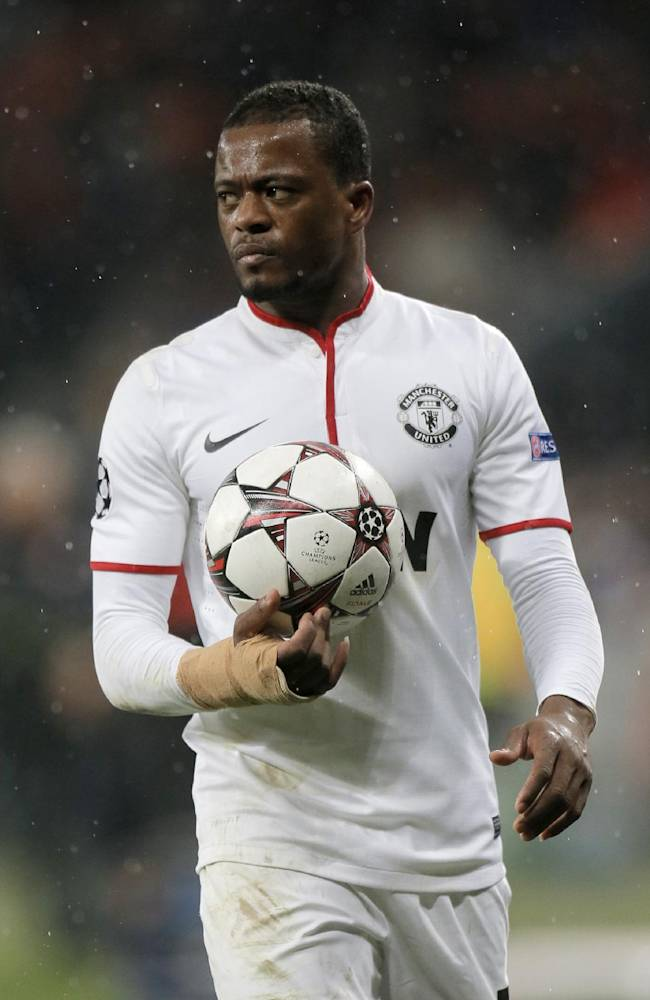 Manchester United's Patrice Evra holds the ball during the Champions League Group A soccer match against  Shakhtar Donetsk at Donbass Arena Stadium in Donetsk, Ukraine, Wednesday, Oct. 2, 2013