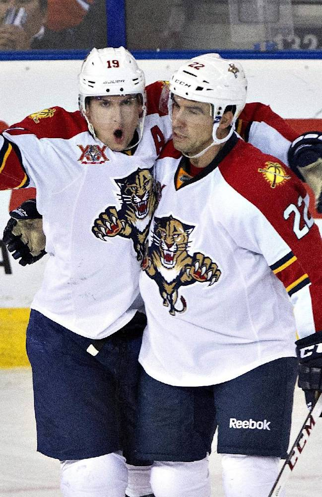 Florida Panthers' Scottie Upshall (19) and Mike Mottau (22) celebrate a goal on the Edmonton Oilers during second period NHL hockey action in Edmonton, Alberta, on Thursday Nov. 21, 2013