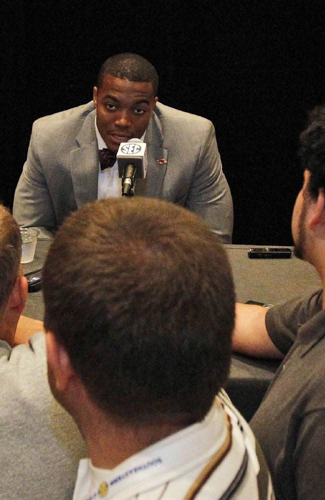 Arkansas defensive end Trey Flowers speaks to the media at the Southeastern Conference NCAA college football media days, Wednesday, July 16, 2014, in Hoover, Ala