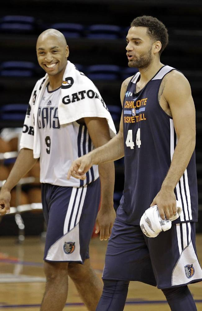 Charlotte Bobcats' Gerald Henderson, left, jokes with Jeffery Taylor after a practice at the NBA basketball team's training camp in Asheville, N.C., Wednesday, Oct. 2, 2013