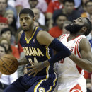 Indiana Pacers' Paul George (24) pushes against Houston Rockets' James Harden in the first half of an NBA basketball game on Friday, March 7, 2014, in Houston. (AP Photo/Pat Sullivan)