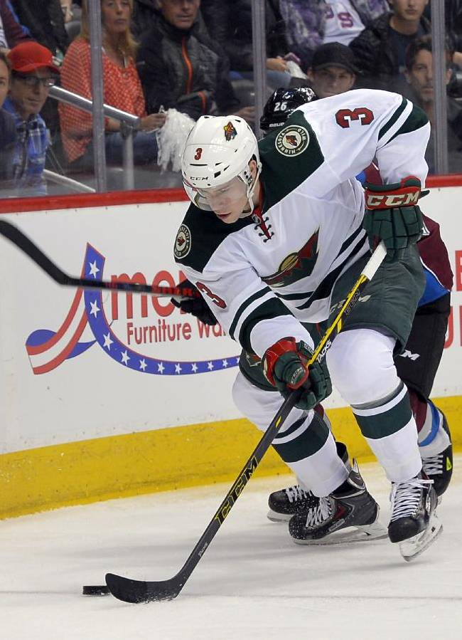 Minnesota Wild center Charlie Coyle (3) skates against Colorado Avalanche center Paul Stastny (26) during the first period in Game 1 of an NHL hockey first-round playoff series on Thursday, April 17, 2014, in Denver