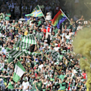 Portland Timbers fans, go wild as the their team score a goal at a game against the Seattle Sounders during an an MLS soccer match in Portland, Ore., Sunday, Aug. 24, 2014. The Sounders won the game 4 to 1 The Associated Press