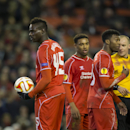 Liverpool's Daniel Sturridge, right, remonstrates with teammate Mario Balotelli, left, while Jordon Ibe looks on as the latter insists on taking a penalty during the Europa League Round of 32 soccer match between Liverpool and Besiktas at Anfield Stadium