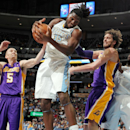 Denver Nuggets forward Kenneth Faried, second from left, pulls down a rebound as Los Angeles Lakers guard Steve Blake, left, and forward Pau Gasol, third from left, of Spain, stand by with Nuggets forward J.J. Hickson in the fourth quarter of the Nuggets'