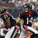 Houston Texans' Arian Foster (23) takes the hand off from quarterback Ryan Fitzpatrick (14) during the first half of an NFL football game against the Dallas Cowboys, Sunday, Oct. 5, 2014, in Arlington, Texas The Associated Press