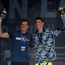 Jul 1, 2016; Omaha, NE, USA; Michael Phelps (right) and Ryan Lochte celebrate after winning the mens 200 meter individual medley final in the U.S. Olympic swimming team trials at CenturyLink Center. Mandatory Credit: Erich Schlegel-USA TODAY Sports