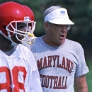 FILE - In this Aug.14, 1990, file photo, Maryland coach Joe Krivak yells out instructions during the first day of NCAA college football practice in College Park, Md. Krivak, Maryland's football coach from 1987-91, died Tuesday night, Dec. 25, 2012, the university announced. He was 77. (AP Photo/Carlos Osorio, File)