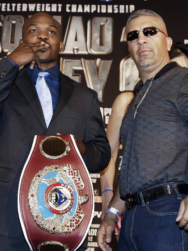 Tim Bradley, left, and his trainer Joel Diaz, pose at a news conference to promote their upcoming WBO welterweight championship boxing rematch against Manny Pacquiao, Pacquiao Bradley 2, in Beverly Hills, Calif., Tuesday, Feb. 4, 2014. Pacquiao and Bradley's first match on June 9, 2012 was a split decision in favor of Bradley, which ended Pacquiao's welterweight title reign as well as his seven-year, 15-bout winning streak. Pacquiao vs. Bradley 2 will take place Saturday, April 12, 2014, in Las Vegas