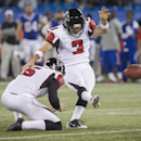 Atlanta Falcons kicker Matt Bryant kicks the game winning field goal with Matt Bosher, left, to defeat the Buffalo Bills in overtime of football NFL action in Toronto, Sunday Dec. 1, 2013 The Associated Press