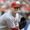 St. Louis Cardinals starting pitcher John Lackey throws to the San Francisco Giants during the first inning of Game 3 of the National League baseball championship series Tuesday, Oct. 14, 2014, in San Francisco. (AP Photo/Harry How, pool)