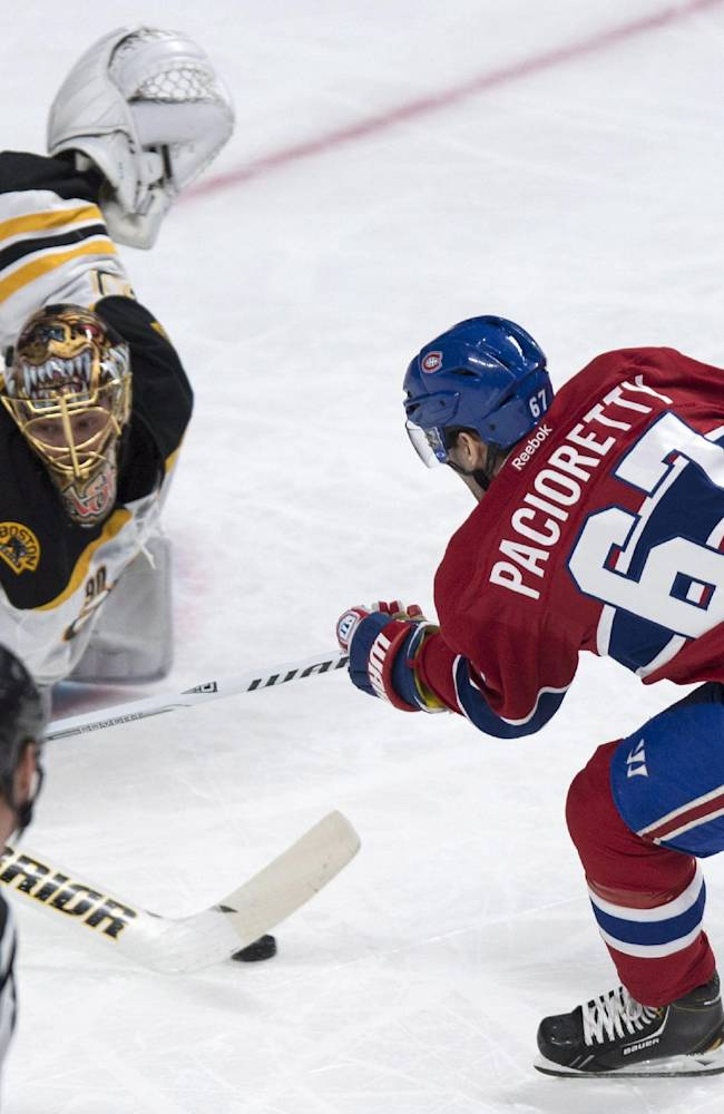Boston Bruins goalie Tuukka Rask makes a save off Montreal Canadiens' Max Pacioretty during first period NHL hockey action Wednesday, March 12, 2014 in Montreal