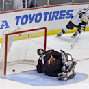 Anaheim Ducks goalie Jonas Hiller (1), of Switzerland, reacts after Pittsburgh Penguins left winger Chris Kunitz (14) makes a shootout goal in an NHL hockey game in Anaheim, Calif., Friday, March 7, 2014. The Penguins won the shootout, 3-2 The Associated