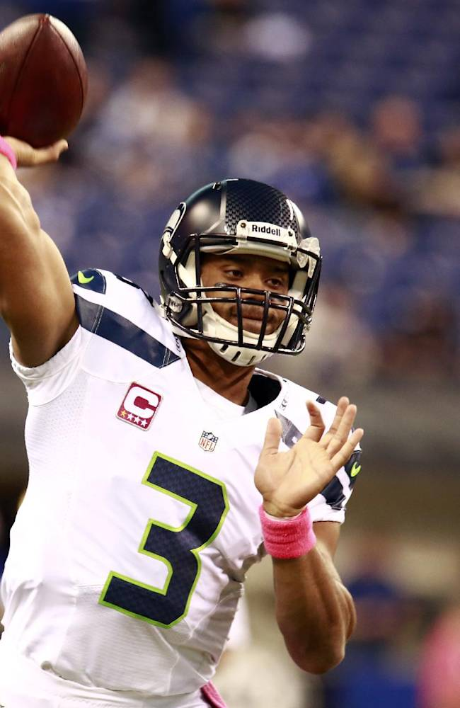 Seattle Seahawks quarterback Russell Wilson throws before an NFL football game against the Indianapolis Colts in Indianapolis, Sunday, Oct. 6, 2013