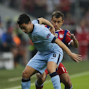 Manchester City's Samir Nasri, left, and Bayern's Rafinha challenge for the ball during the Champions League Group E soccer match between FC Bayern Munich and Manchester City at Allianz Arena in Munich, southern Germany, Wednesday Sept. 17, 2014