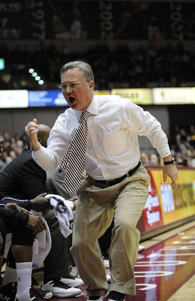Southern Illinois head coach Barry Hinson yells to a player to enter the game during the first period of an NCAA college basketball game against Creighton at SIU Arena in Carbondale, Ill., Sunday, Jan. 27, 2013