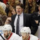 Detroit Red Wings head coach Mike Babcock, top, yells to his team during the first period of Game 5 of the NHL hockey Stanley Cup playoffs Western Conference semifinals against the Chicago Blackhawks in Chicago, Saturday, May 25, 2013. (AP Photo/Nam Y. Huh)