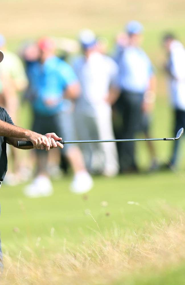 Bubba Watson of the US plays out of the rough on the 12th hole during the first day of the British Open Golf championship at the Royal Liverpool golf club, Hoylake, England, Thursday July 17, 2014