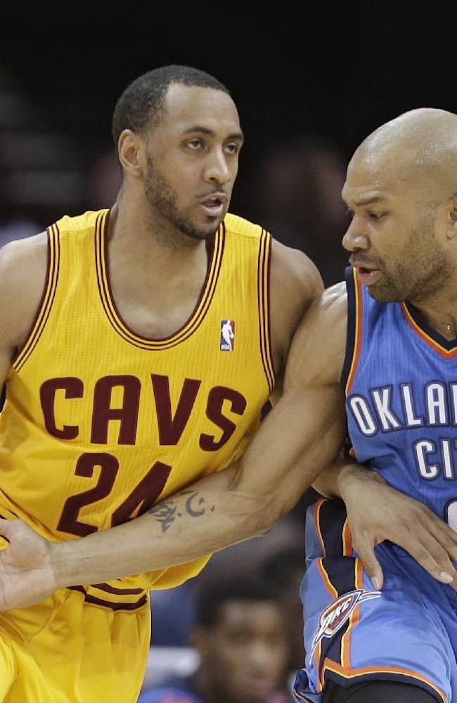 Cleveland Cavaliers' Shane Edwards (24) drives against Oklahoma City Thunder's Derek Fisher (6) during the third quarter of an NBA basketball game Thursday, March 20, 2014, in Cleveland. Oklahoma defeated Cleveland 102-95
