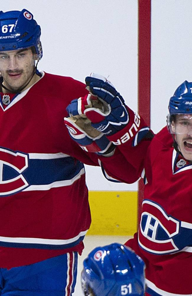 Montreal Canadiens' Max Pacioretty celebrates with teammate Brendan Gallagher, right, after scoring against the Minnesota Wild  during the second period of an NHL hockey game Tuesday, Nov. 19, 2013 in Montreal