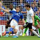 Leicester's Chris Wood, middle, is tackled by Everton's Gareth Barry, right, and Sylvain Distin during the English Premier League soccer match between Leicester City and Everton at King Power Stadium, in Leicester, England, Saturday, Aug 16, 2014
