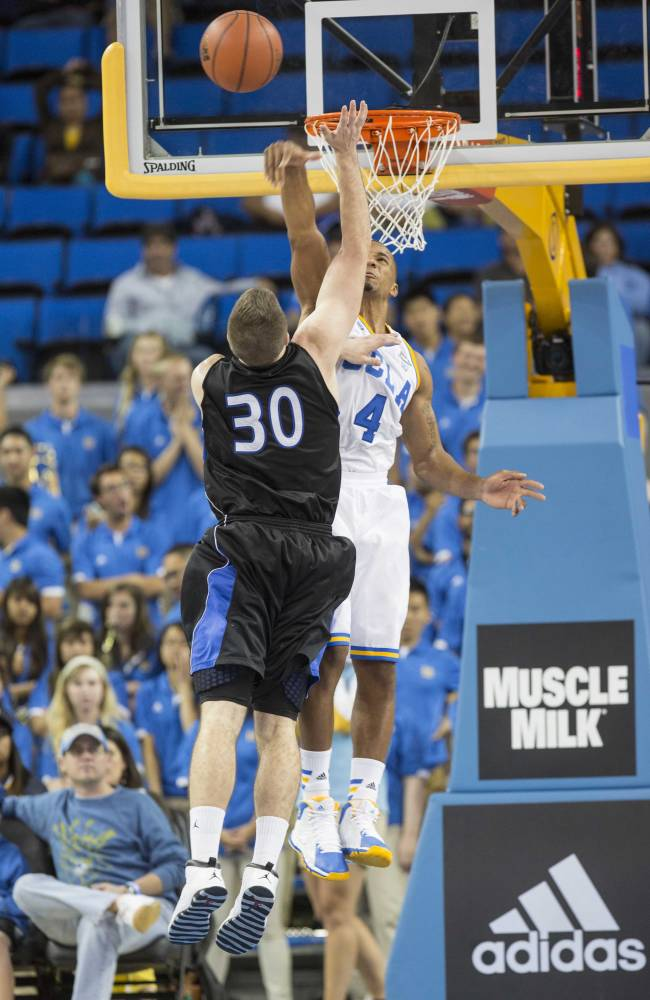 UCLA's Norman Powell (4) tries to block a ball shot by Cal State San Bernardino's Casey Oldemoppen in the second half of an NCAA college exhibition  basketball game on Wednesday, Oct. 30, 2013, in Los Angeles. UCLA won 96-66