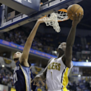 Indiana Pacers guard Lance Stephenson, right, gets a bucket on a shot under Memphis Grizzlies forward Tayshaun Prince in the second half of an NBA basketball game in Indianapolis, Monday, Nov. 11, 2013. The Pacers defeated the Grizzlies 95-79. Stephenson