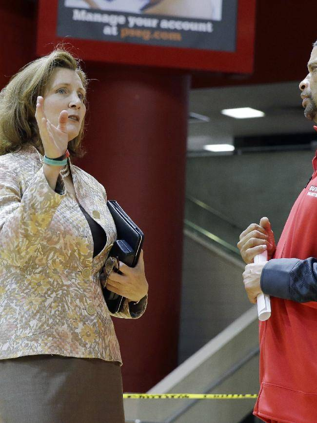 Rutgers University athletic director Julie Hermann, left, talks to men's basketball head coach Eddie Jordan as they stand in the Rutgers Athletic Center in Piscataway, N.J., Tuesday, Oct. 22, 2013. Jordan was named head coach in April and Hermann athletic director in May, as the school sought to move forward from a scandal that forced the firing of coach Mike Rice and the resignation of athletic director Tim Pernetti