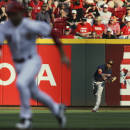 Minnesota Twins left fielder Eddie Rosario cannot throw out Cincinnati Reds' Joey Votto as he advances to third off a hit by Marlon Byrd in the second inning of a baseball game, Monday, June 29, 2015, in Cincinnati. (AP Photo/John Minchillo)