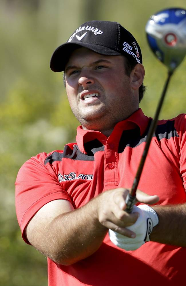 Patrick Reed watches his tee shot on the 17th hole in his match against George Coetzee, of South Africa, during the second round of the Match Play Championship golf tournament on Thursday, Feb. 20, 2014, in Marana, Ariz