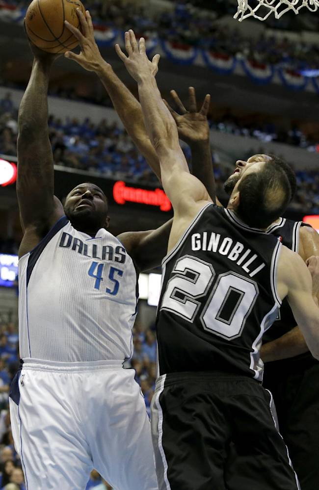Dallas Mavericks' DeJuan Blair (45) goes up to shoot while contested by San Antonio Spurs' Manu Ginobili (20), of Argentina, and Tim Duncan in the first half of Game 6 of an NBA basketball first-round playoff series on Friday, May 2, 2014, in Dallas. (AP Photo/Tony Gutierrez)
