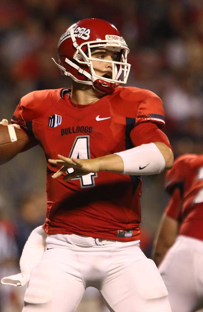 Fresno State's Derek Carr looks to pass during the first half of an NCAA college football game Saturday, Oct. 19, 2013, in Fresno, Calif