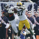Green Bay Packers cornerback Sam Shields (37) breaks up a pass intended for Chicago Bears wide receiver Alshon Jeffery (17) in the first half of an NFL football game Sunday, Sept. 28, 2014, in Chicago. The Associated Press