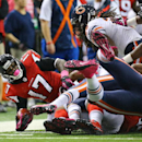 Atlanta Falcons wide receiver Devin Hester is taken down by Chicago Bears defenders after a short kick off return during the NFL football game on Sunday, Oct. 12, 2014, in Atlanta The Associated Press