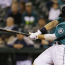 Seattle Mariners' Justin Smoak hits a two-run go-ahead double in the eighth inning of a baseball game against the Tampa Bay Rays, Friday, Sept. 6, 2013, in Seattle. (AP Photo/Ted S. Warren)