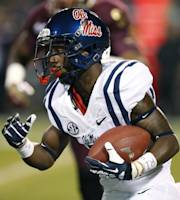 Mississippi running back Jaylen Walton runs for a long yards against Mississippi State during the first half of an NCAA college football game on Thursday, Nov. 28, 2013, in Starkville, Miss. (AP Photo/Rogelio V. Solis)