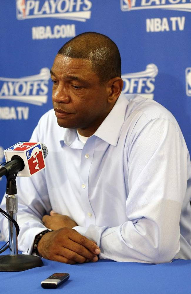 Los Angeles Clippers head coach Doc Rivers, right, answers questions during a pregame news conference before Game 4 of an opening-round NBA basketball playoff series against the Golden State Warriors on Sunday, April 27, 2014, in Oakland, Calif