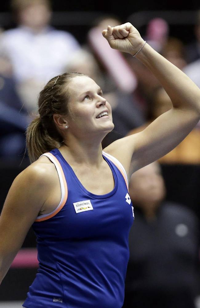 Italy's Karin Knapp celebrates after defeating United States' Christina McHale during a Fed Cup world group tennis match Saturday, Feb. 8, 2014, in Cleveland