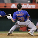 New York Mets' Daniel Murphy looses his helmet as he avoids a pitch during the 13th inning of a baseball game against the Los Angeles Angels on Saturday, April 12, 2014, in Anaheim, Calif The Associated Press