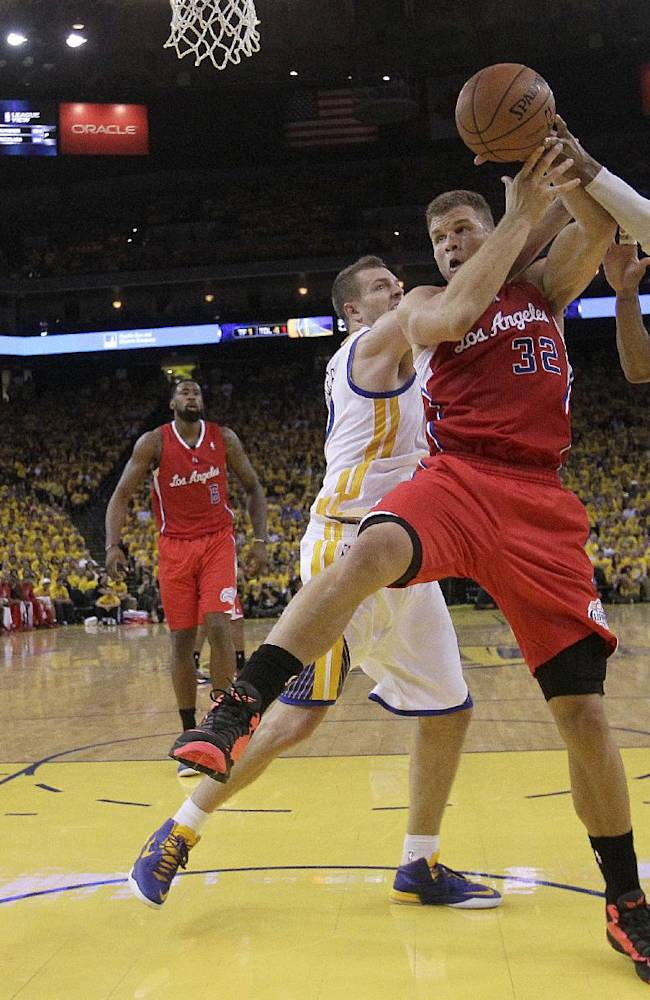 Los Angeles Clippers forward Blake Griffin (32) tries to control the ball as he is guarded by Golden State Warriors power forward David Lee, center left, and small forward Andre Iguodala  during the second half of Game 6 of an opening-round NBA basketball playoff series in Oakland, Calif., Thursday, May 1, 2014. The Warriors won 100-99
